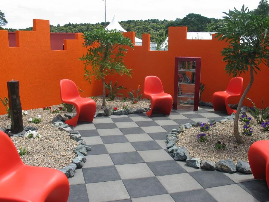 bright-garden-design-with-orange-furniture-decoration-with-ornament-and-gravel
